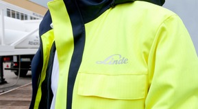 HiQ PPE Linde safety coat worn by people with production site background